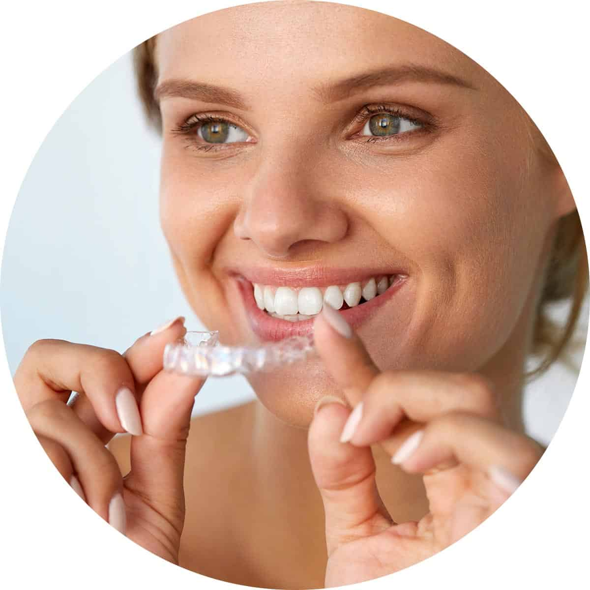 Invisalign clear aligner being inserted by patient